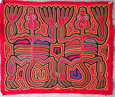 The Two Frogs Mola is truly a masterpiece...older collectable molas are very rarely found in this pristine condition. This mola was made in the early 1960s, and is a perfect example of the Cuna art at its very height. The remarkable design is very skillfully executed. Take a close look at the tiny stitches, the complexity of the pattern and the fact that every square inch of the panel is decorated! This degree of skill, design, and condition is not often found in the more modern Molas you…