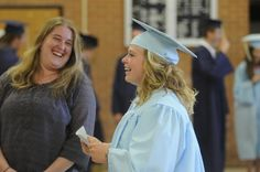 Hillsdale High School graduates turn their tassels during Commencement exercises Sunday May 31, 2015 at Hillsdale High School.