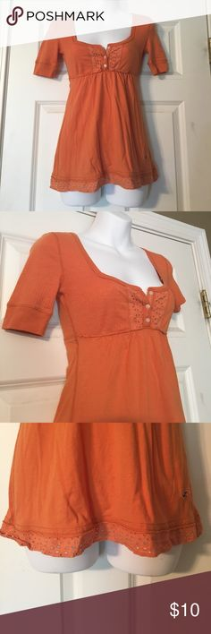 Hollister Top Pretty orange flowy top from Hollister, in good condition still. If you have any questions, feel free to ask! :) Hollister Tops