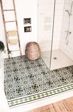 Green pattern floor tiles, basket, leaning towel ladder, shower