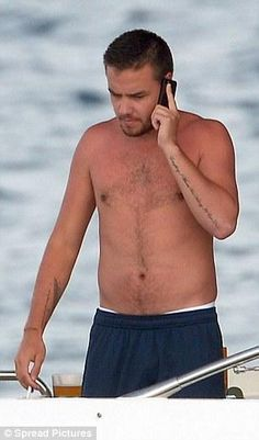 One Direction Manila @1DInfectionMNL  Liam on a yacht in St. Tropez in France with Sophia and Andy - 07/30/14