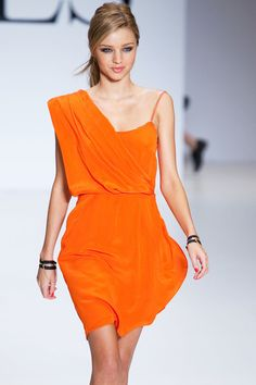 Such a cute orange spring dress for a party!