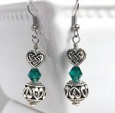 A personal favorite from my Etsy shop https://www.etsy.com/listing/584118952/heart-earrings-silver-and-green-heart