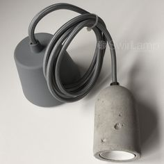 Stoere beton snoerpendel. Leuk met een grote LED Globe lamp, alleen of in een groepje.