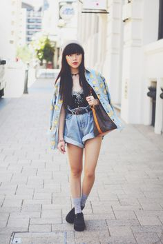 Street Style: 90s style: quirky double denim with high waist shorts and comic trend Bart Simpson jacket