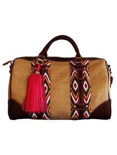 Artisan crafted handbag, woven basket and diamond print Wayuu fabric, red tassel detail
