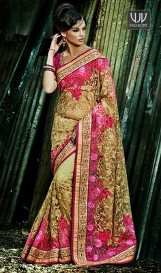 Attractive Beige And Pink Net Designer N Stylish saree Attractive beige and pink net designer n stylish saree. The saree featuring of heavy floral embroidery work at all over & embroidery & Stone lace work with two side pipping. Matching blouse available with this saree.