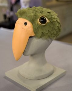 In-house crafter Kristin St. Clair took inspiration from her pet bird, Pico, to develop this gorgeous headpiece.