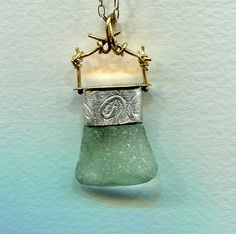 Sea Glass, sterling embossed with spiral, topped with brass...great for summer.