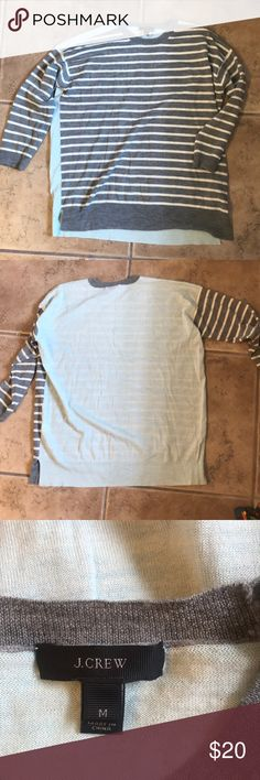 Striped JCrew sweater ⭐️ worn once! Three quarter length sleeved, striped JCrew sweater. Light-weight. Front and sleeves are grey and white striped and back is color blocked solid aqua. Slits i the sides for a loose, comfortable fit. J. Crew Sweaters Crew & Scoop Necks