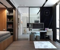 This space triples as an office, living room, and bedroom. But the large windows and glass wall into the kitchen help this otherwise tiny space feel spacious.