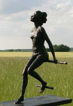 "'Girl on a Promenade' bronze resin sculpture by artist Mitchell House;  approximately 12"" x 10"" x 6"""
