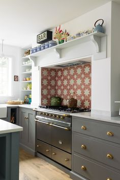 The Datchworth Kitchen by deVOL features a Lacanche range cooker and a quirky tiled splashback