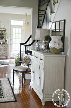 CREATING A WELCOMING FOYER-mirror above foyer cabinet.black accents, gray walls, white ( or white washed) furniture. Decor, Foyer Cabinet, Home Furnishings, Home Furniture, House Interior, House, Interior, Home Decor, Furniture