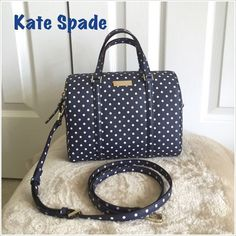 "HP ❤️👏 Authentic Kate Spade Mini Cassie Satchel Host Pick 5/2 Girl Power Party 😄👏Authentic Kate Spade - Grant Street Grainy Vinyl Mini Cassie Satchel Bag. Style WKRU 3104. Color- Navy Blue/Cream. Size 9"" L x 6.5"" H x 4.5"" W (base). Has handle drop length 9.8"" and removable/adjustable strap length 49.6"". This purse is made of classic polka dot printed saffiano textured grainy vinyl and a custom woven stripe inside lining. The hardware are plated light gold. Its a zip top closure bag with…"