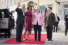 German Chancellor Angela Merkel and her husband Joachim Sauer greeting President Barack Obama and First Lady Michelle Obama USWNT VS GERMANY Bible News, Matthew 24, People Of Interest, Women's World Cup, American Presidents, Michelle Obama, Barack Obama, Purple Dress, Amazing Women