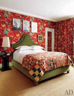 The master bedroom of perfumer Frédéric Malle's New York City apartment is cocooned in a lively GP & J Baker fabric from Lee Jofa. Malle expertly paired the vivid floral print with a sculptural bed of his own design and a neutral sisal floor covering. (May 2011)