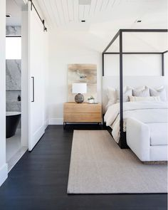 Dark floors, black canopy bed frame, and creamy neutral tones. this bedroom by is sending us into the weekend with all kinds of Master Bedroom Design, Home Bedroom, Modern Bedroom, Bedroom Decor, Modern Canopy Bed, Bedroom Ideas, Coastal Master Bedroom, Natural Bedroom, Bedroom Signs