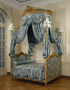 Bed (Lit à la Polonaise)  	    Unknown   French, Paris, about 1775 - 1780   Painted and gilded walnut, gilded iron, modern silk upholstery and passementerie, and ostrich feathers  9 ft. 11 in. x 5 ft. 10 1/2 in. x 7 ft. 5 in.   94.DA.72