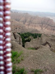 Badlands in South Dakota wearing pearls