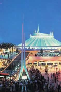 vintage photo of space mountain with the old escalators, and the stage underneath.