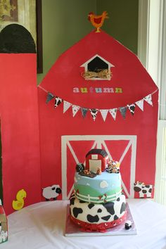 "The cake at my daughters first birthday party.  My oldest daughter and I made the barn, my friend made the cake. the barn on the cake top was removable and used as her ""smash"" cake"