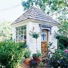 Really love the found architectural details on this small shed.