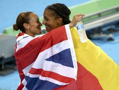 Jessica Ennis-Hill embraces the new Olympic heptathlon champion Naffi Thaim following her narrow overall victory at Rio 2016