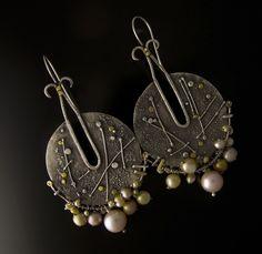 """Shields"" SS earrings by Debra Colonna, 22 and 24K gold."