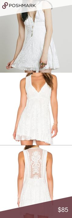 FREE PEOPLE REIGN OVER ME SLEEVELESS DRESS Sleeveless version of FP fave Reign Over Me Dress, this deep V mini dress has a sheer mesh overlay with beautiful embroidery and scalloped trim. Hidden side zip. Lined. Care/Import Machine Wash Cold Import Free People Dresses Mini