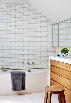 Kids bathroom upstairs.  Stool from Zuster.  Photo - Sean Fennessy, production – Lucy Feagins / The Design Files.