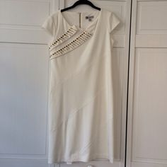 Leslie Fay White Dress w Gold Embellishments Brsutifuk white Leslie Fay dress with gold embellishments. Perfect for a special day at work or evening occasion. You don't have to add much jewelry in this outfit since the dress already provides some sparkle. Great condition. NO trades. NO Pal. Price is Firm. Leslie Fay Dresses