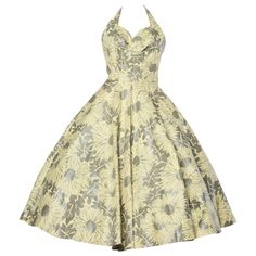 Vintage 1950s 50s Gold + Yellow Floral Print Halter Dress with a Full Sweep | From a collection of rare vintage day dresses at http://www.1stdibs.com/fashion/clothing/day-dresses/