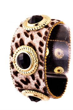 My favorite gold and onyx, lovely leopard  cuff bracelet.  I keep it at home in my jewelry box,..