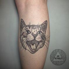 Cattoo.  Cat head tattoo, dotwork tattoo, dotworker, fine liner, linework tattoo, pointillism tattoo, reductive realism tattoo, blackwork tattoo, blackworker