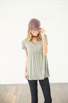 This Mossy Oak Peplum Top is so airy and beautiful! This is such a perfect transition piece into spring and what a fun color. This green peplum top is so refreshing and so easy to wear, the shirt just does it all. We love the simplicity of this top and believe that pairing it with a pair of distressed pants and booties will make you look like show stopper.    Bella Ella Boutique    Mossy Oak Peplum Top Bella Ella Boutique Online Store