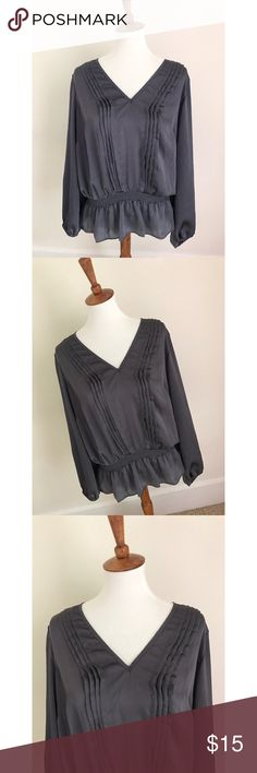 Michael Kors silk blouse - Size XL. Michael Kors silk blouse with peplum detailing in a grey/silver color.  - I don't trade, and I do not sell outside of posh. - I ship every single day!  - All items come from a smoke free home!  - If you have anymore questions just let me know and I would be happy to help! 🙂 Michael Kors Tops Blouses