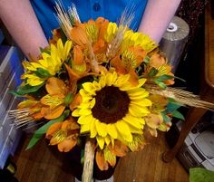Sunflower and Alstroemeria with Wheat Bouquet... maybe not quite so big but I love the sunflowers with an orange accenting flower.
