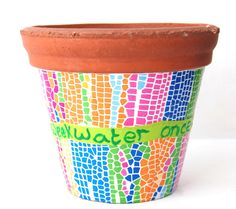 Revamp tired plant pots or personalise flower pots using Decopatch paper.