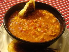 Folks moving to this part of the country (Georgia) often fall in love with Brunswick Stew, usually a side dish at barbecue restaurants. This version is delicious but simple to make. People feud over whether the stew should have potatoes and lima beans in it, but this is a purist stew (except for the sneaky addition of potato flakes).