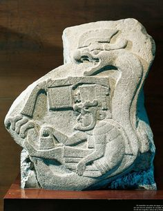 Relief depicting priest making offerings and snake behind him, from La Venta, Mexico
