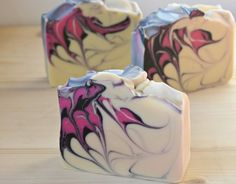 Cold process soap with coconut milk, natural tussah silk, hanger swirl, with charcoal