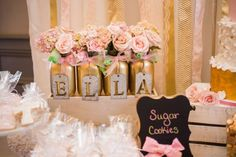 Pretty cookie favors at a pink & gold baptism party! See more party ideas at CatchMyParty.com!
