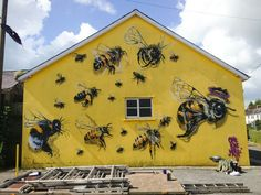 Street artist Louis Masai Michel is on a one-man mission to raise awareness of the plight of the humble honey bee through his Save the Bees mural project. Quince Honey Farm, Devon, UK