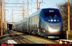 Amtrak Acela #2019 leading the new non-stop Acela Express Train #2183. The Acela Express is running south (west) past Holmesburg Junction, Philadelphia Pennsylvania. 3/8/01.