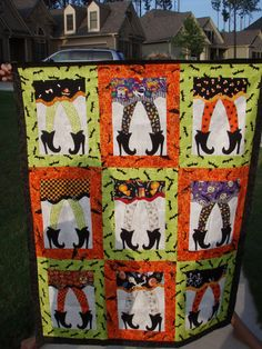 Halloween quilt - i have the pattern, want to do a wallhanging. If you do this in reds and greens they look like elves shoes.