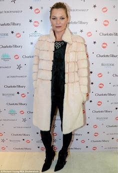 Style star: Kate Moss  headed to Charlotte Tilbury's star-studded Christmas party  in London's Covent Garden on Thursday evening