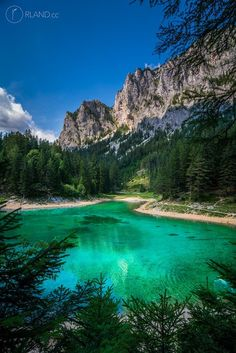 "The famous ""Green Lake"" (""Grüner See"") in Styria / Austria, known for breathtaking underwater-images - in spring, when snowmelt-water is lifting the water level some more meters, divers can capture flowers, pathways, benches and trees under crystal clear water. A truly breathtaking place."