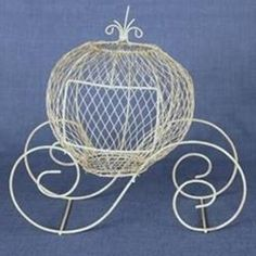 This antique ivory fairytale coach wire and metal form is perfect to add to your wedding decorations and centerpiece when you are planning a fairytale wedding.  You could easily spray paint this fairytale piece a different color to coordiante with your wedding or event decor.