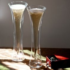 """With it's devilish good looks and hourglass silhouette, the Diablo champagne glass just may be the sexiest method of imbibing your bubbles.  Borosilicate glass Double layer, insulating design Hand wash 10"""" x 3"""" 4 fl. oz.  Please allow 1-2 weeks for delivery."""